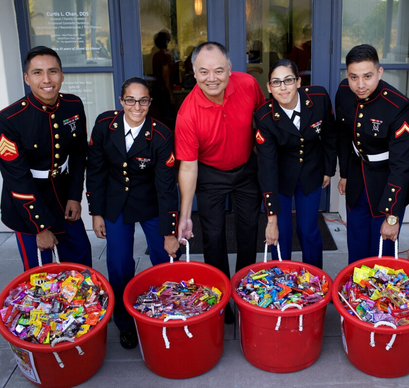 Dr. Curtis Chan with donations for the troops at a previous Candy Buy Back event.