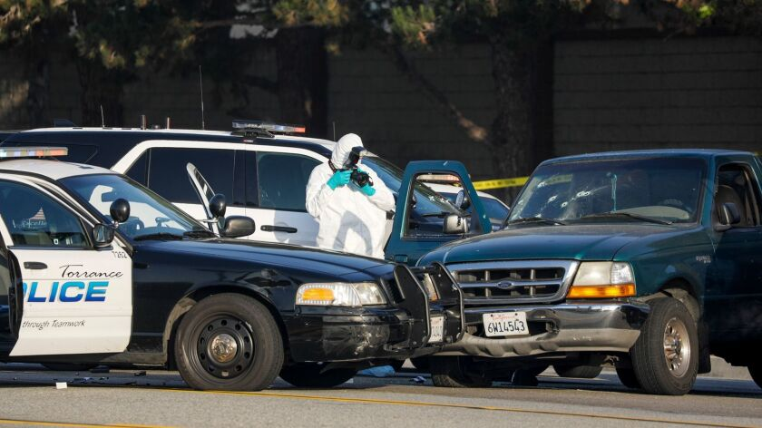 Investigators at scene of officer-involved shooting in Torrance early Saturday.
