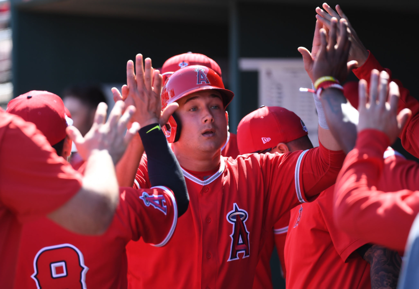 Angels' Matt Thaiss celebrates with teammates in the dugout.