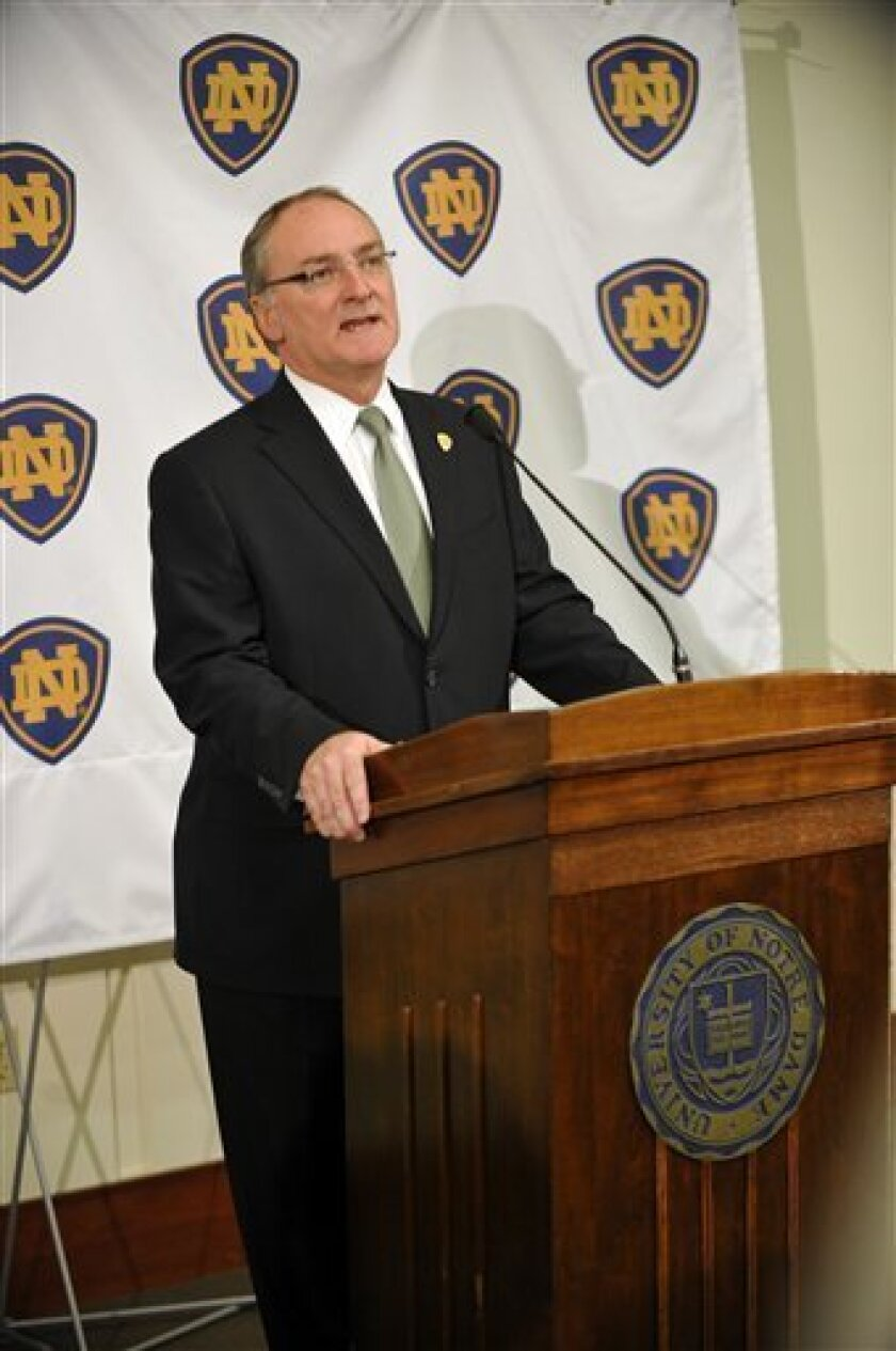 Notre Dame athletic director Jack Swarbrick talks with the media about the firing of coach Charlie Weis Monday Nov. 30, 2009. Notre Dame fired Weis on Monday after a string of disappointing seasons that was capped by an agonizing four-game losing streak. Swarbrick said he recommended to university president the Rev. John Jenkins on Sunday night that Weis be let go with six years left on his contract. Weis leaves his alma mater with a 35-27 record in five seasons, among the worst of any Notre Dame coach. (AP Photo/Joe Raymond)