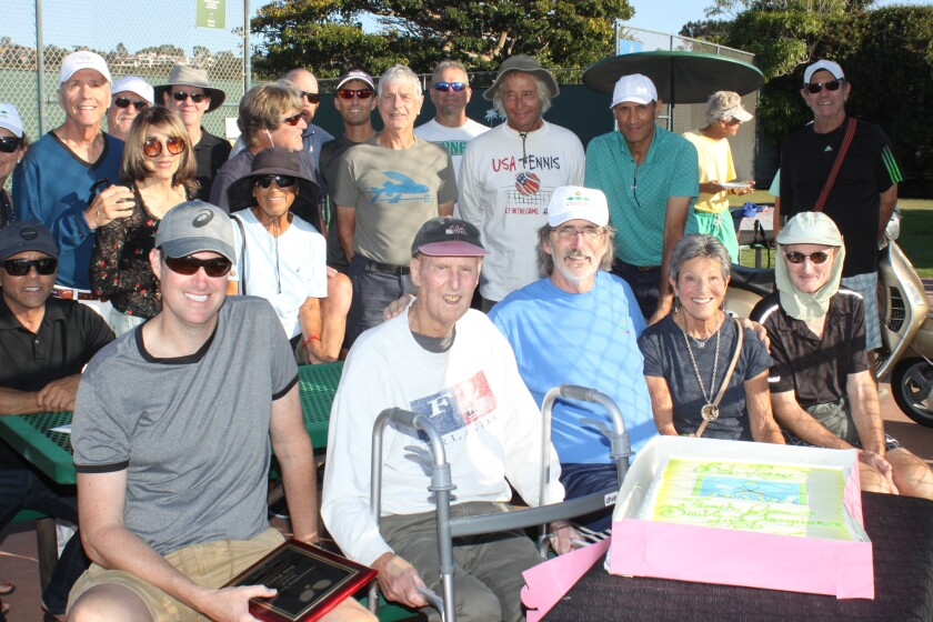 Friends and La Jolla Tennis Club members surround former tennis director Bob Perry (front, second from left), at a ceremony Oct. 5 recognizing his contribution to the Club.