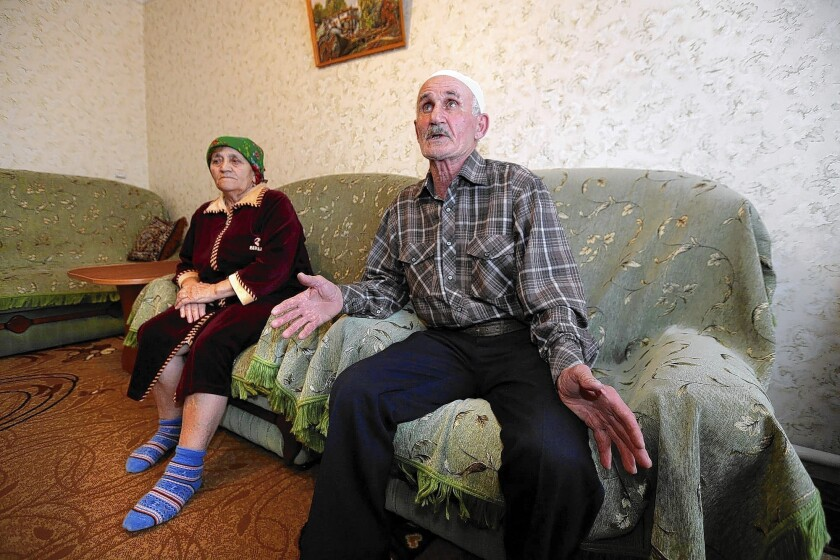 Crimean Tatars Jafer Abdulkerimov and his wife, Sheide, survived the 1944 deportation of Tatars under Stalin. The presence of Russian troops in Crimea is recalling memories from that dark era, they say.