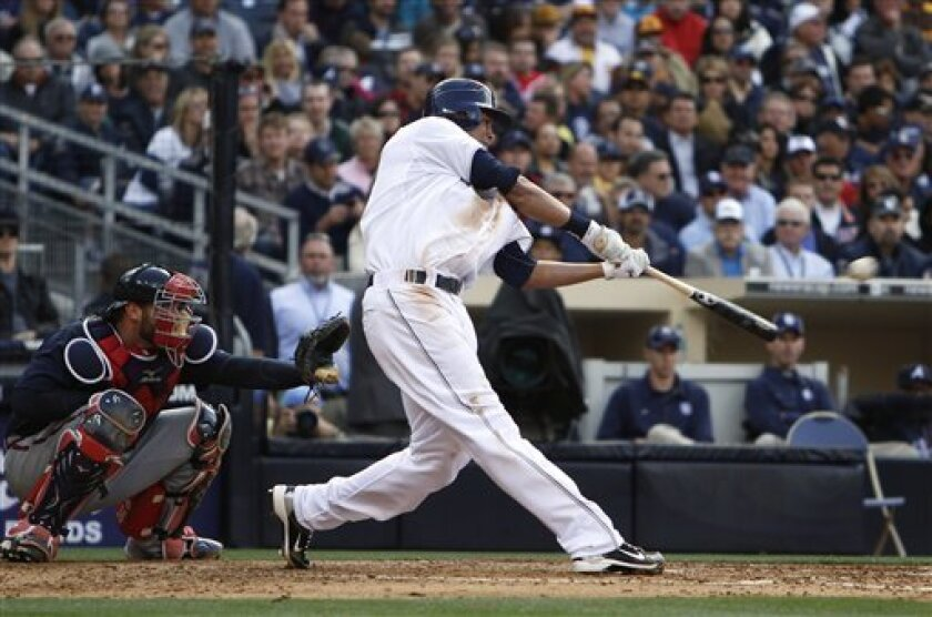 San Diego Padres' Will Venable launches a two-run homer against the Atlanta Braves during the Padres' 10-run fourth inning in a baseball game Monday April 12, 2010 in San Diego. (AP Photo/Lenny Ignelzi)