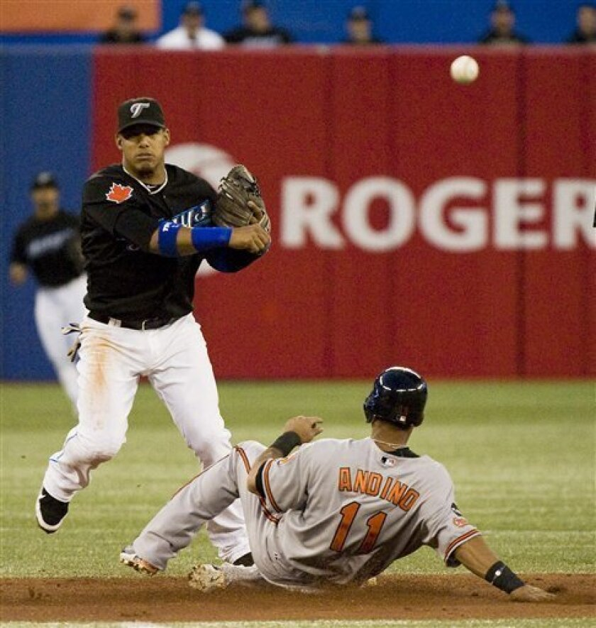 Toronto Blue Jays second baseman Kelly Johnson outs Baltimore Orioles' Robert Andino (11) in a double play during the third inning of a baseball game in Toronto, Friday, Sept. 9, 2011. (AP Photo/The Canadian Press, Aaron Vincent Elkaim)