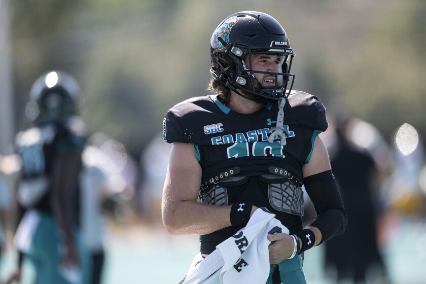 Coastal Carolina's Grayson McCall warms up before to an NCAA college football game against Louisiana Monroe on Saturday, Oct. 2, 2021, in Conway, S.C. (AP Photo/Matt Kelley)
