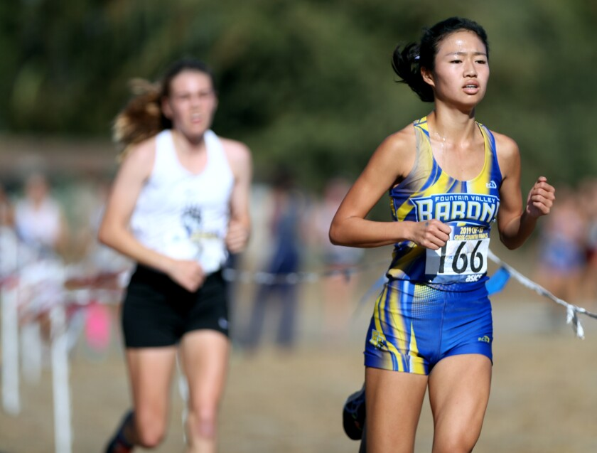 Fountain Valley's Kaho Cichon runs at Riverside City Cross-Country Course on Nov. 23, 2019.