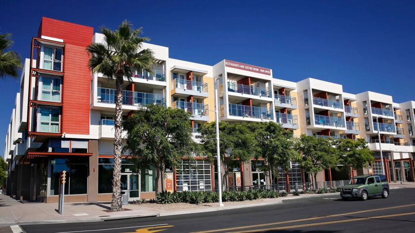 Mercado del Barrio includes 92 apartments on the upper floors of the main building and retail on the
