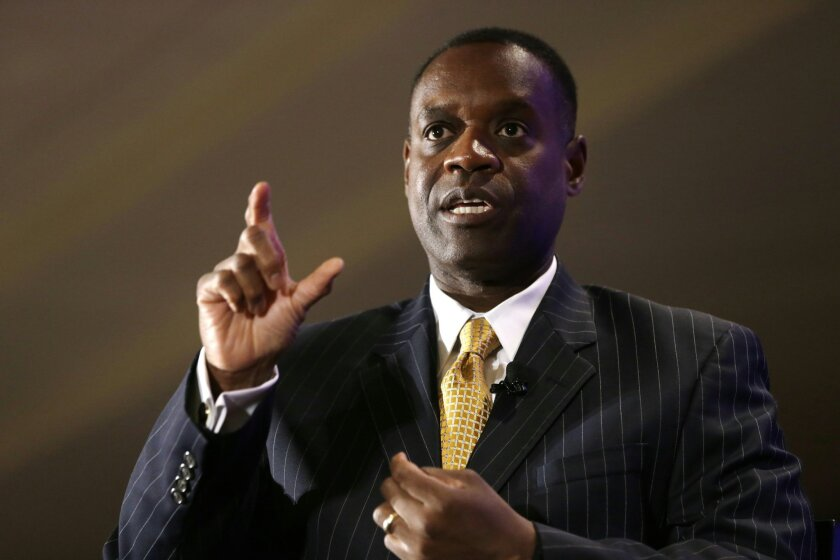File- This Oct. 3, 2013, file photo shows Detroit Emergency Manager Kevyn Orr gesturing during an interview at the Detroit Economic Club luncheon in Detroit. A proposed plan to restructure Detroit's debt calls for retirees and pensioners to receive $4.3 billion in payments and bondholders about $1.