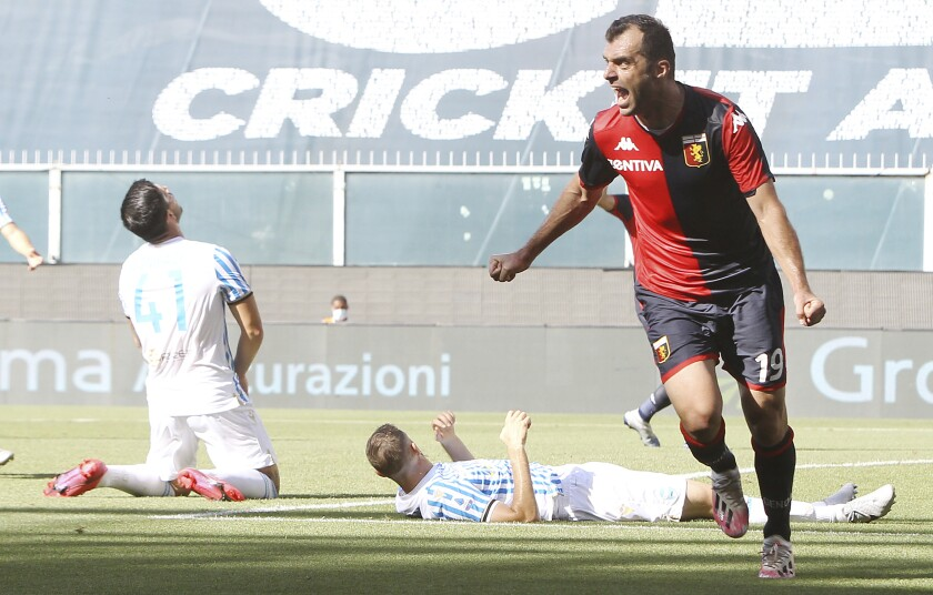 Genoa's Goran Pandev, right, celebrates after scoring his side's opening goal during a Serie A soccer match between Genoa and SPAL at the Luigi Ferraris Stadium in Genoa, Italy, Sunday, July 12, 2020. (Tano Pecoraro/LaPresse via AP)