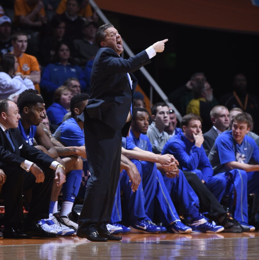 Kentucky coach John Calipari yells on the sideline against Tennessee in the second half of an NCAA college basketball game Tuesday, Feb. 17, 2015, in Knoxville, Tenn. (AP Photo/Patrick Murphy-Racey)