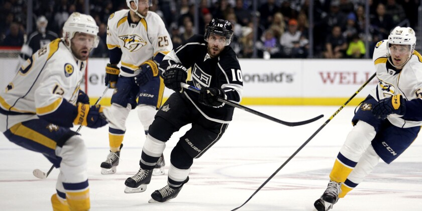 Kings center Mike Richards (10) sends the puck into the offensive zone against the Nashville Predators on Jan. 3.