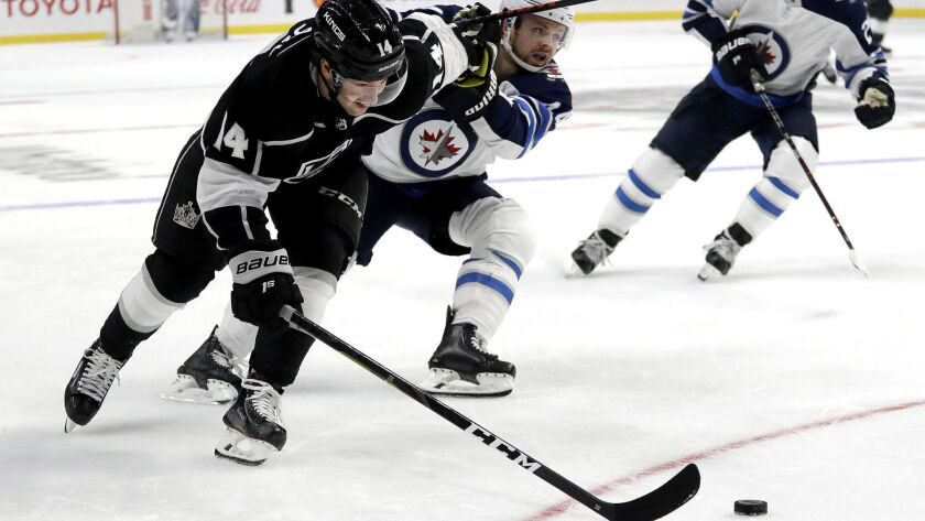 Los Angeles Kings left wing Brendan Leipsic vies for the puck against Winnipeg Jets defenseman Josh