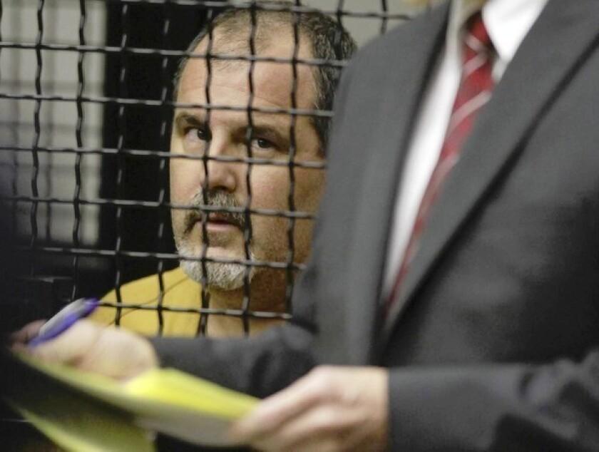 Hearing for salon shooting suspect postponed