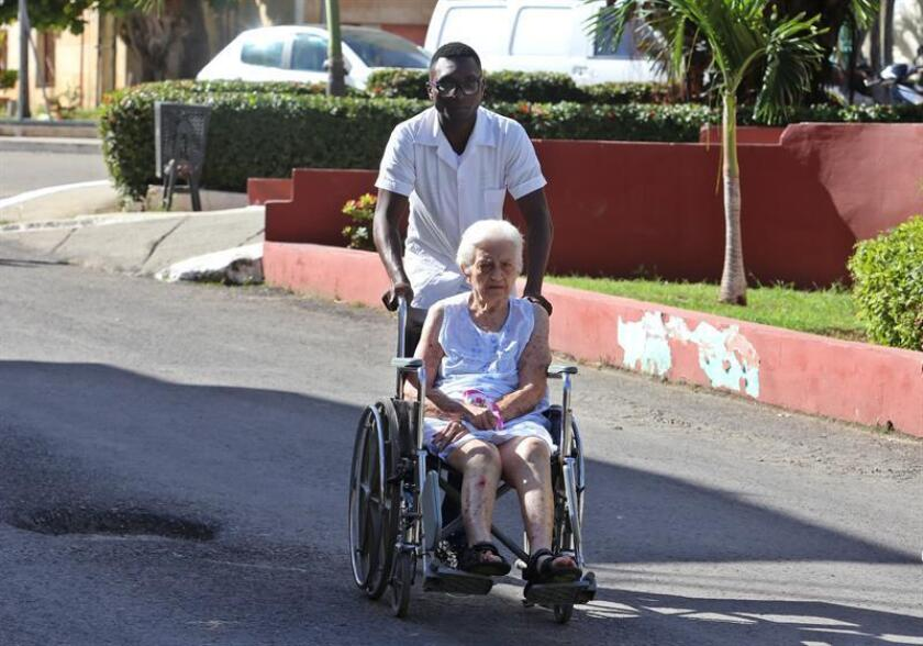 A health worker helps a woman in a wheelchair at the Calixto Garcia Hospital in Havana, Cuba, on Nov. 14, 2018. Cuba announced on Nov. 14 that it is withdrawing from Brazil's Mais Medicos' (More Doctors) program due to threats and derogatory comments by President-elect Jair Bolsonaro, who has proposed changes to the program that Cuba deems unacceptable. EPA-EFE/Yander Zamora