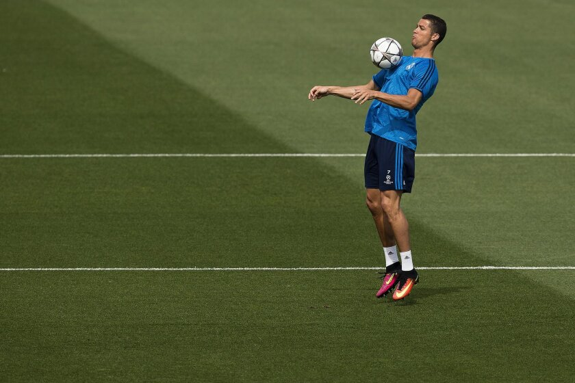 Real Madrid Cristiano Ronaldo plays with a ball during a training session ahead of Saturday's Champions League soccer match final between Atletico de Madrid and Real Madrid, at the Valdebebas stadium in Madrid, Spain, Tuesday, May 24, 2016 . (AP Photo/Daniel Ochoa de Olza)