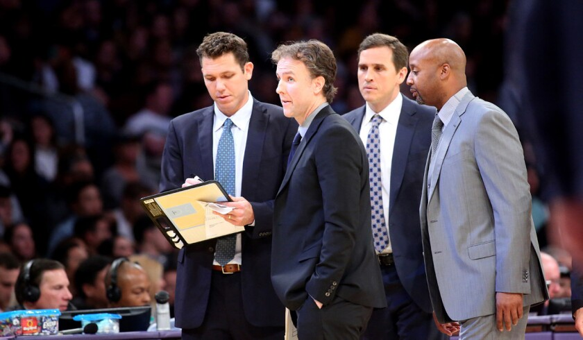 Lakers player development coach Brian Keefe, second from left, joins Coach Luke Walton left, and assistant coaches Mark Madsen and Brian Shaw during a timeout in a Nov. 22 game against the Oklahoma City Thunder.