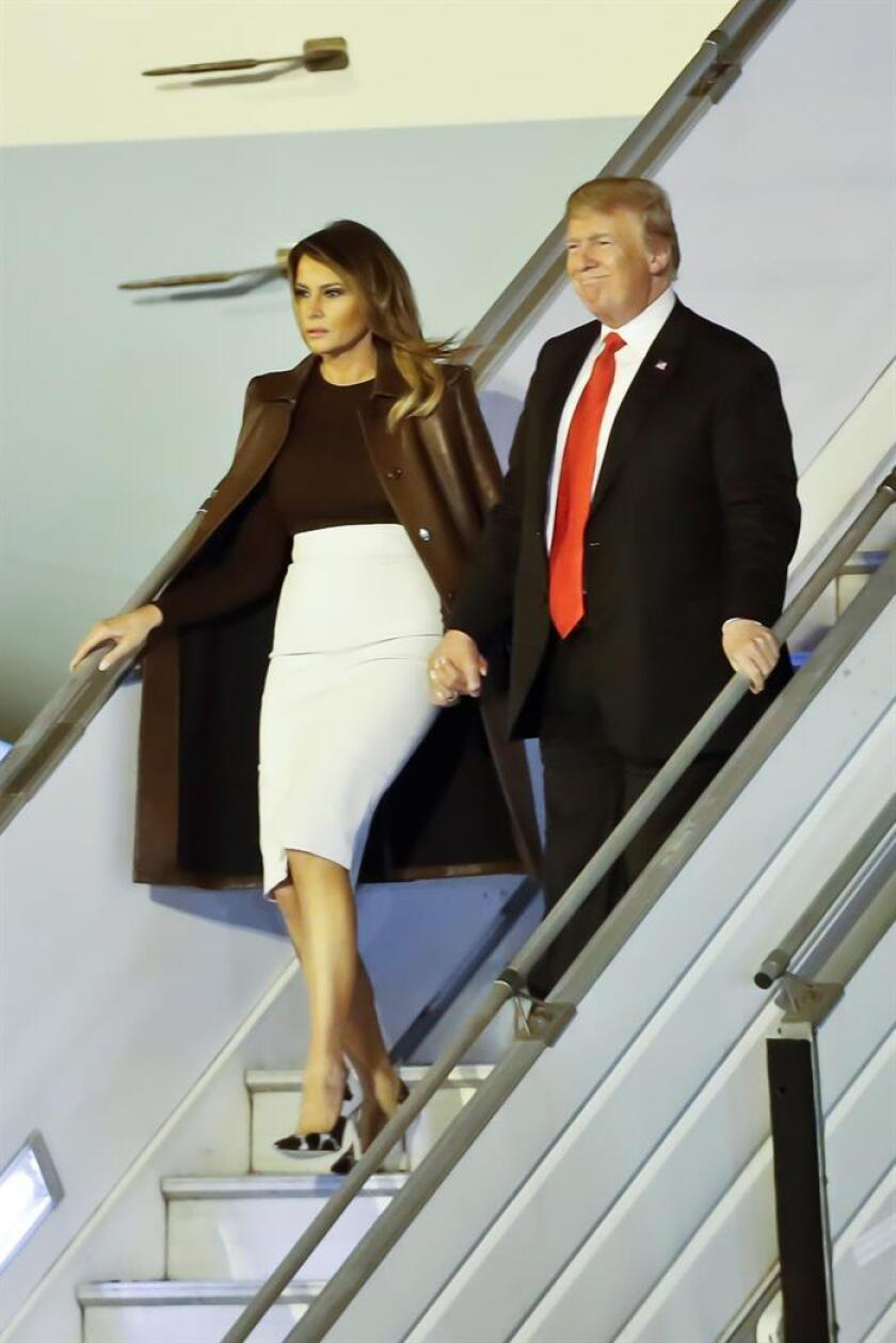 US President Donald J. Trump (R) and First Lady Melania Trump (L) arrive to the Ezeiza International Airport in Buenos Aires, Argentina, 29 November 2018. President Trump arrived to attend the G-20 summit of leaders, which marks his first visit to Latin America since he came to power almost two years ago. The 2018 G20 Buenos Aires summit will take place from 30 November to 01 December. EPA-EFE/JUAN IGNACIO RONCORONI