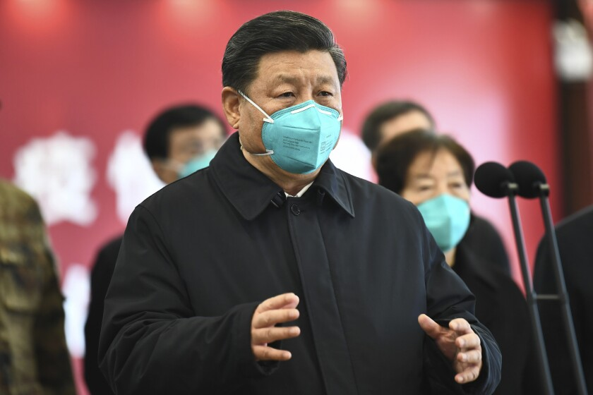 Chinese President Xi Jinping talks March 10 by video with patients and medical workers at the Huoshenshan Hospital in Wuhan.