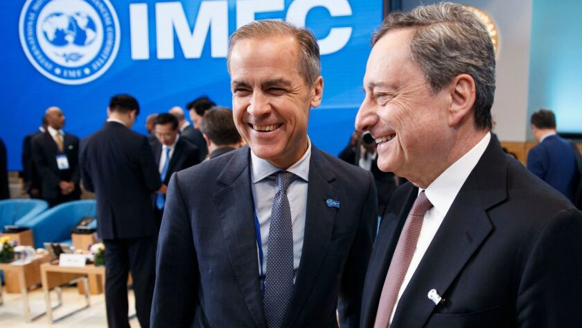 President of the European Central Bank Mario Draghi, right, with Governor of the Bank of England Mark Carney.