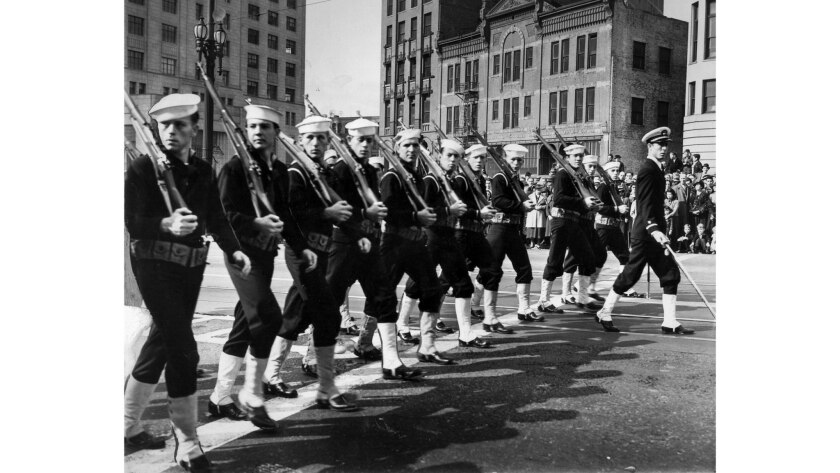 Nov. 11, 1937: A detachment of sailors from the fleet in San Pedro pass reviewing stand in downtown