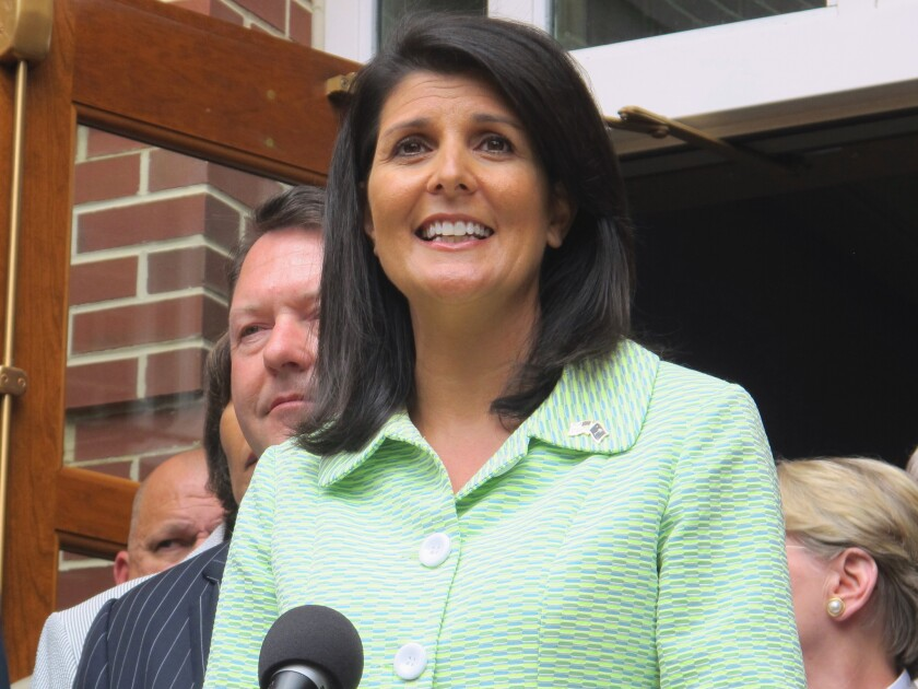 South Carolina Gov. Nikki Haley talks with reporters earlier this month. Haley is expected to sign the state's abortion restrictions into law.