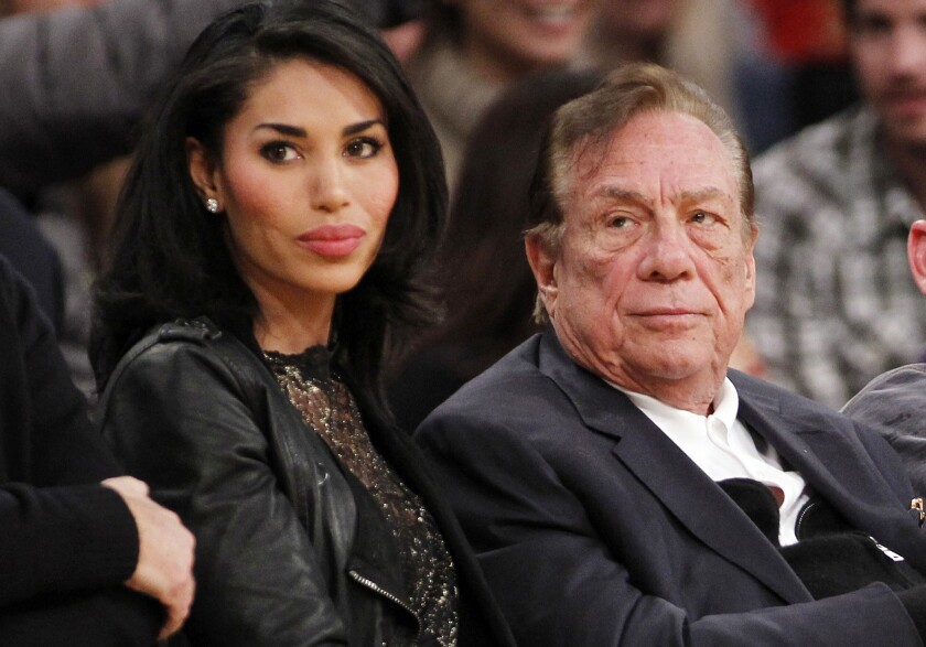 Donald Sterling and V. Stiviano watch the Clippers at Staples Center in 2010.