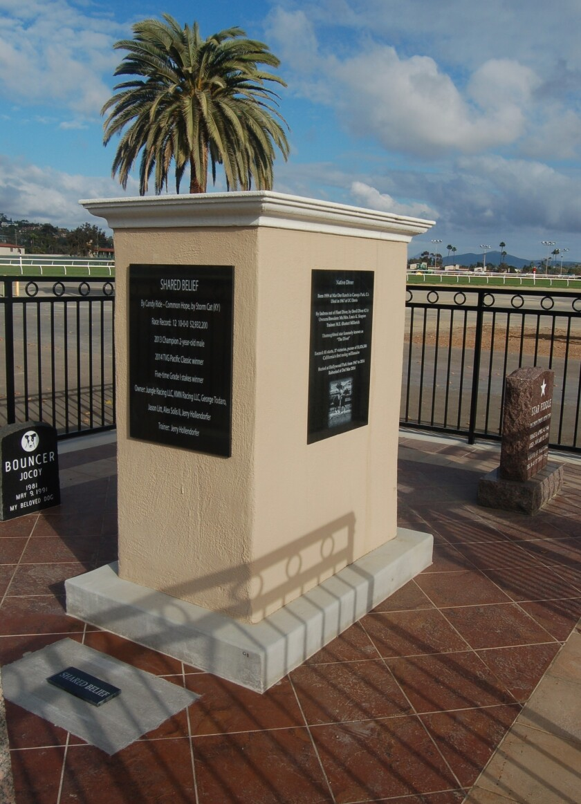 This headstone stands in the small grave yard in the infield at Del Mar.  The west side of the headstone has a memorial to Shared Belief. The side facing south has the details of Native Diver. To the right of the picture is Star Fiddle's grave stone.