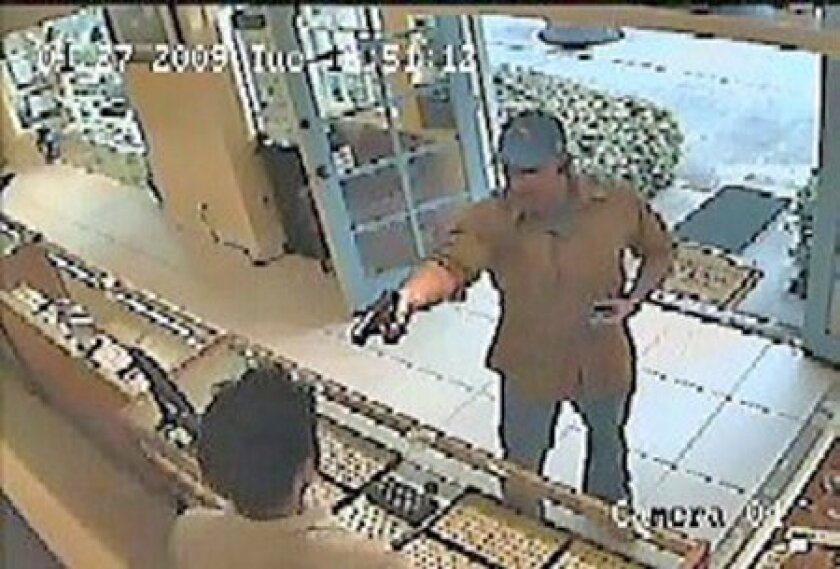 Police seek help identifying the gunman who robbed a La Jolla jewelry store on Jan. 27. He was described as being in his late 30s to early 40s, about 6 feet tall and 185 pounds, with short, light brown hair and cleanshaven. (Crime Stoppers)