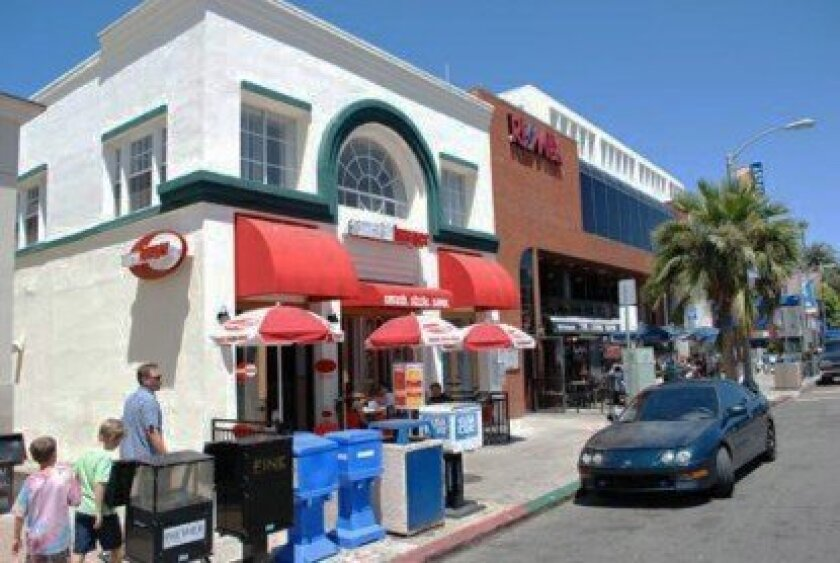 Following an armed robbery of this Smashburger at 1000 Prospect St. on Sunday night, three men and one teen boy were arrested. They are believed to be behind a string of armed robberies in La Jolla and Clairemont during the past three months.