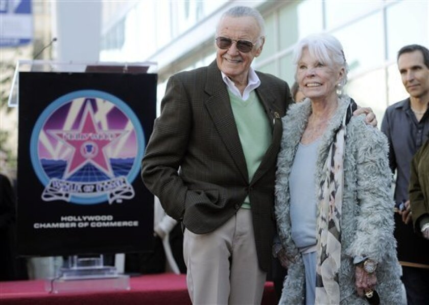 Comic book creator Stan Lee poses with his wife Joan after he received a star on the Hollywood Walk of Fame in Los Angeles, Tuesday, Jan. 4, 2011. (AP Photo/Chris Pizzello)