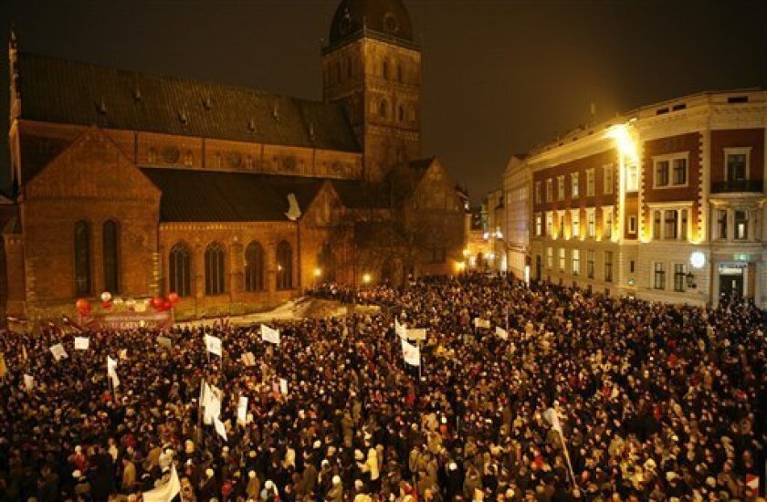Latvians gather for an anti-government rally in Riga's historic Old Town, Latvia, Tuesday, Jan. 13, 2009. Thousands of protesters gathered in downtown Riga to demand the resignation of the center-right government. Latvians are increasingly upset about rising unemployment and unpopular reforms, and