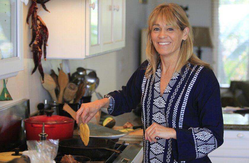 Chef, author and restaurateur Deborah Schneider, cooking at home.