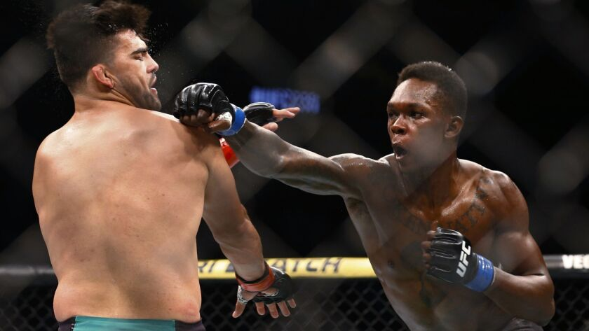 Kelvin Gastelum and Israel Adesanya fight during a middleweight mixed martial arts bout at UFC 236 i