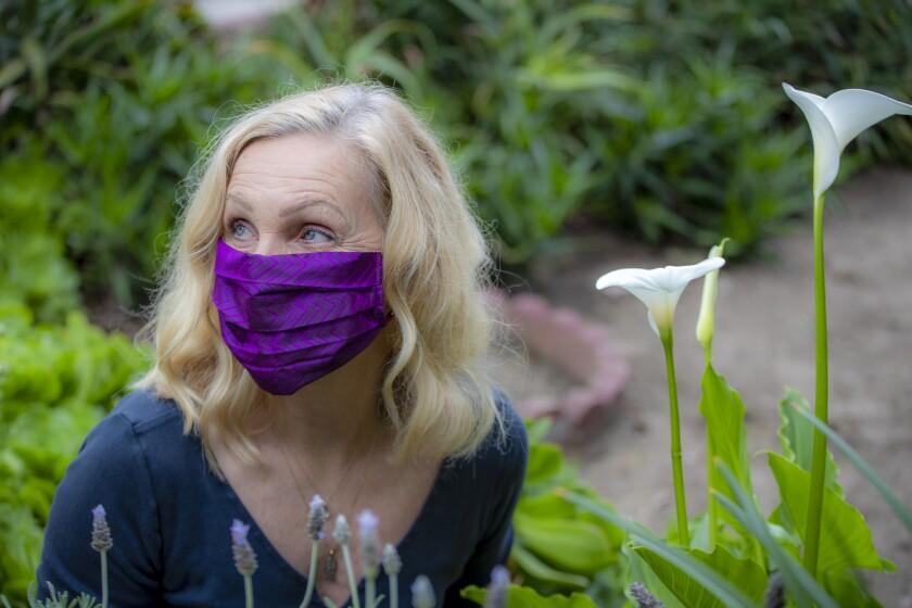 Fashion designer Deborah Lindquist models one of her eco facial masks.