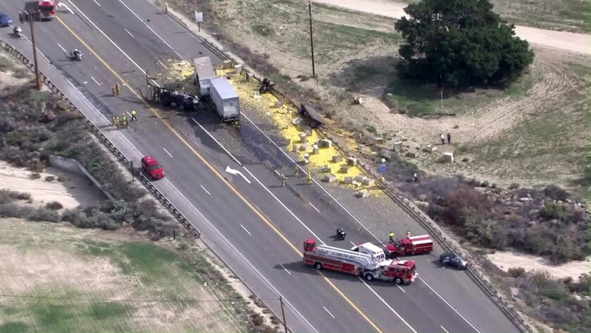 Two people were killed when two big rigs collided with a passenger vehicle Tuesday on Highway 126.
