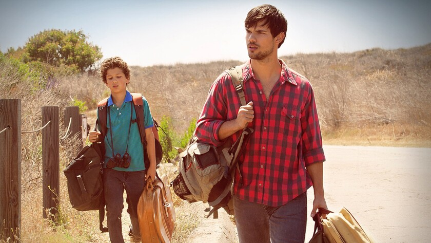 "Nico Christou, left, portrays Oliver and Taylor Lautner is Reymund in ""Run the Tide."""