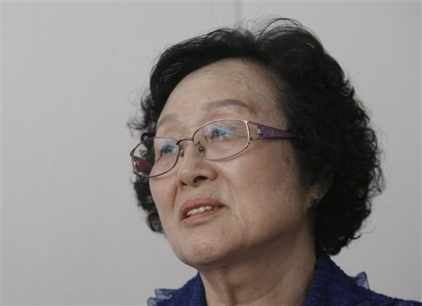 In this June 9, 2010 photo, Chung Hae-yeol, whose father and mother were summarily executed by their own South Korean government early in the Korean War, talks during an interview with The Associated Press in Seoul, South Korea. Shutting down an inquiry into South Korea's hidden history, a century