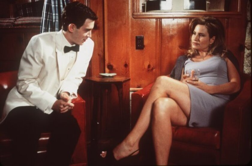 """After the prom, Paul Finch (Eddie Kaye Thomas) attempts to seduce Steve Stifler's mom (Jennifer Coolidge) in a scene from """"American Pie."""""""