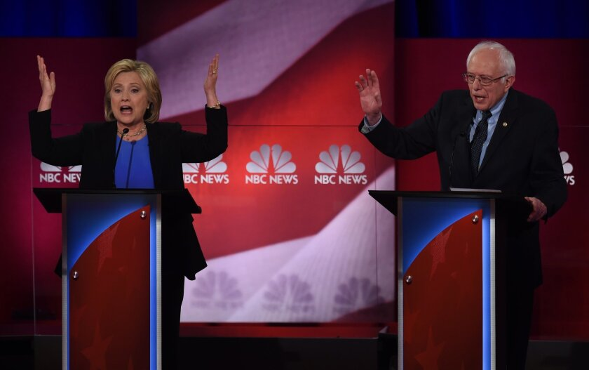Democratic presidential candidates Hillary Clinton and Bernie Sanders debate in Charleston, S.C., on Jan. 17.