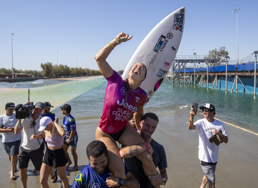 Johanne Defay is carried on friends' shoulders after winning the Jeep Surf Ranch Pro women's event.