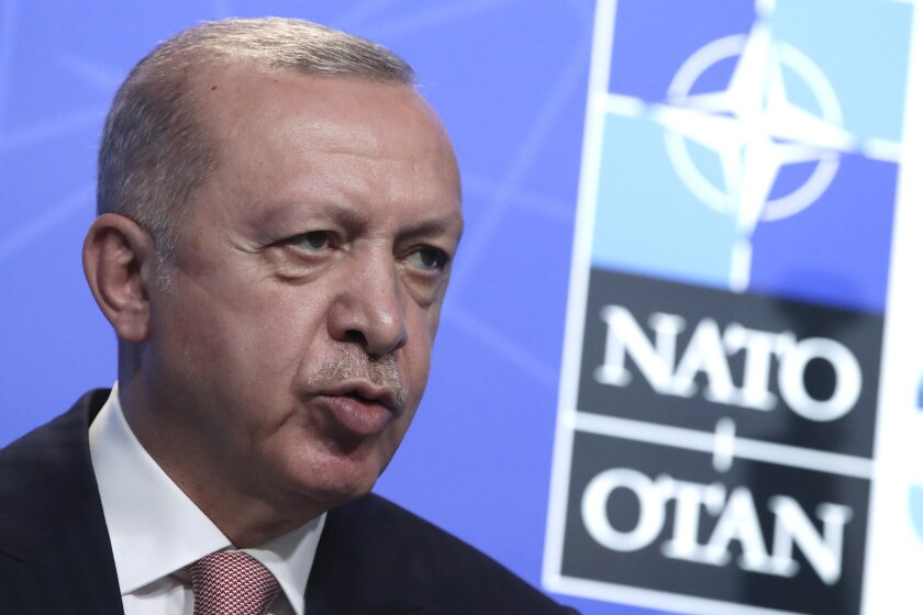 Turkey's President Recep Tayyip Erdogan speaks during a media conference at a NATO summit in Brussels, Monday, June 14, 2021. U.S. President Joe Biden is taking part in his first NATO summit, where the 30-nation alliance hopes to reaffirm its unity and discuss increasingly tense relations with China and Russia, as the organization pulls its troops out after 18 years in Afghanistan. (Yves Herman, Pool via AP)
