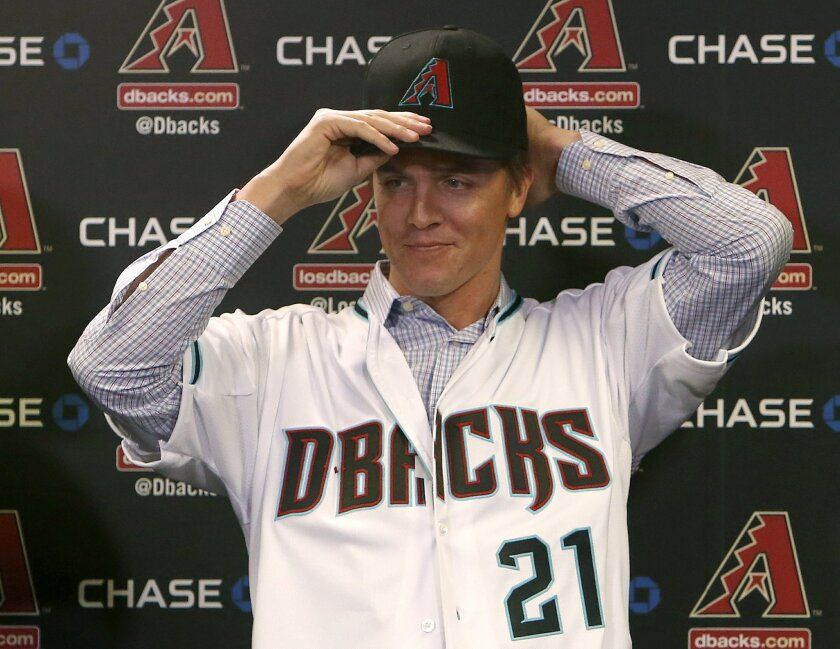 FILE - In this Dec. 11, 2015, file photo, Arizona Diamondbacks pitcher Zack Greinke talks to the media during a press conference in Phoenix. The addition of Zack Greinke, and a couple of other offseason moves, have the Diamondbacks expecting to be contenders.   (AP Photo/Rick Scuteri, File)