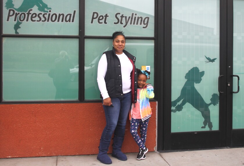 Lena Swann, owner of All About the Dogue in Emeryville, with daughter Caliana
