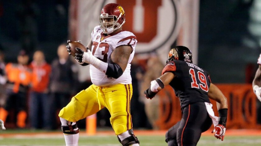 USC offensive tackle Zach Banner catches a lateral on the final play of the Trojans' loss to Utah, 31-27, on Sept. 23.