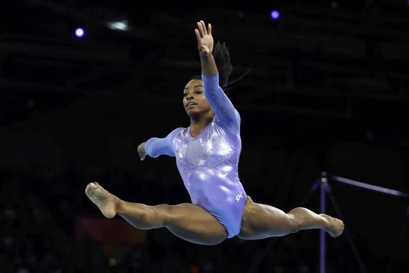 Simone Biles sets medal record at gymnastics worlds - Los ...