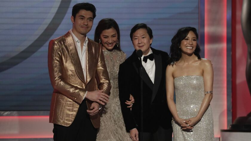 Henry Golding, from left, Michelle Yeoh, Ken Jeong and Constance Wu at the 25th Screen Actors Guild Awards on Sunday at the Los Angeles Shrine Auditorium and Expo Hall.