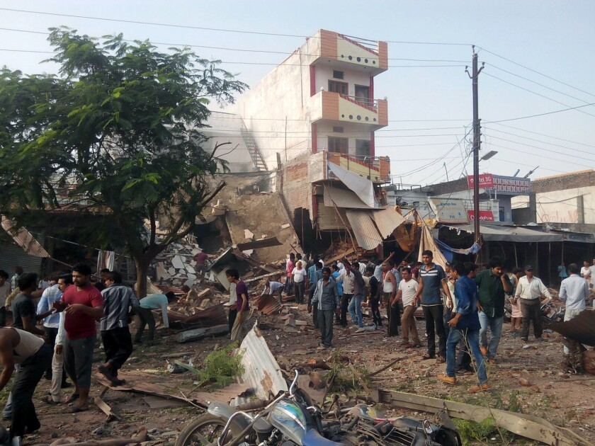 People gather at the explosion site in Jhabua district in central India.