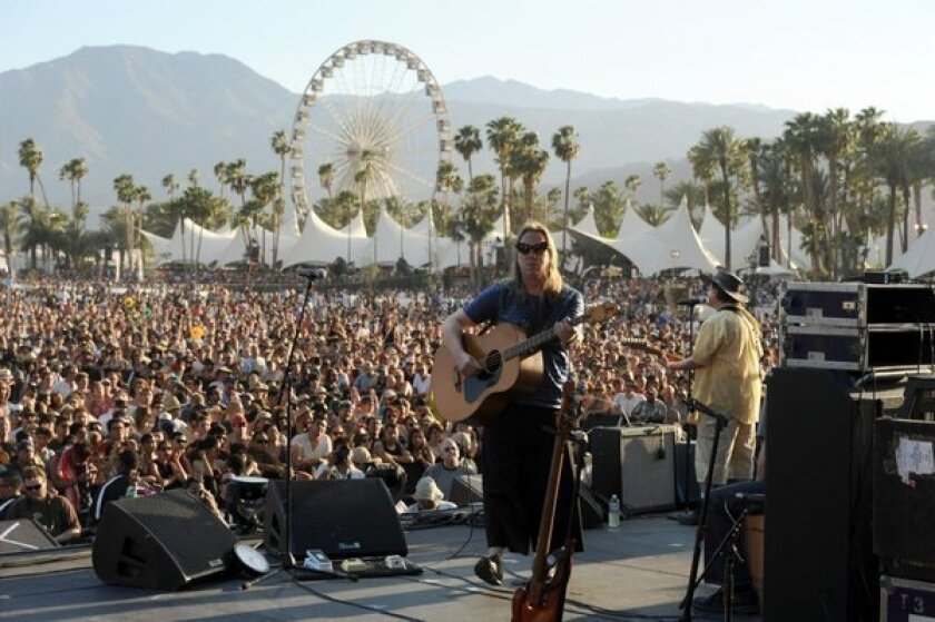 Brian Ritchie, left, and Gordon Gano of the band the Violent Femmes perform onstage during day two.