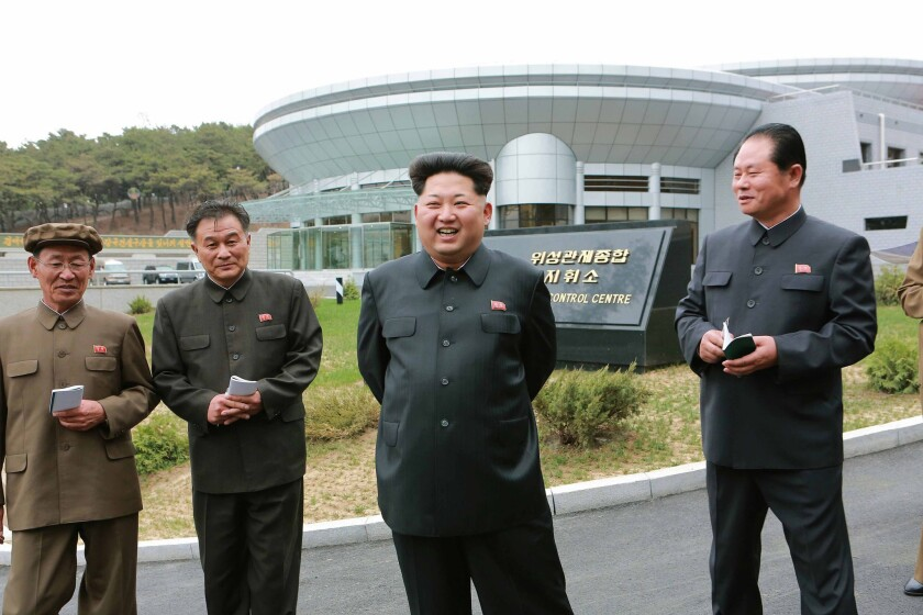 North Korean leader Kim Jong-un, second from right, takes part in an inspection of a new satellite control center at an undisclosed location.