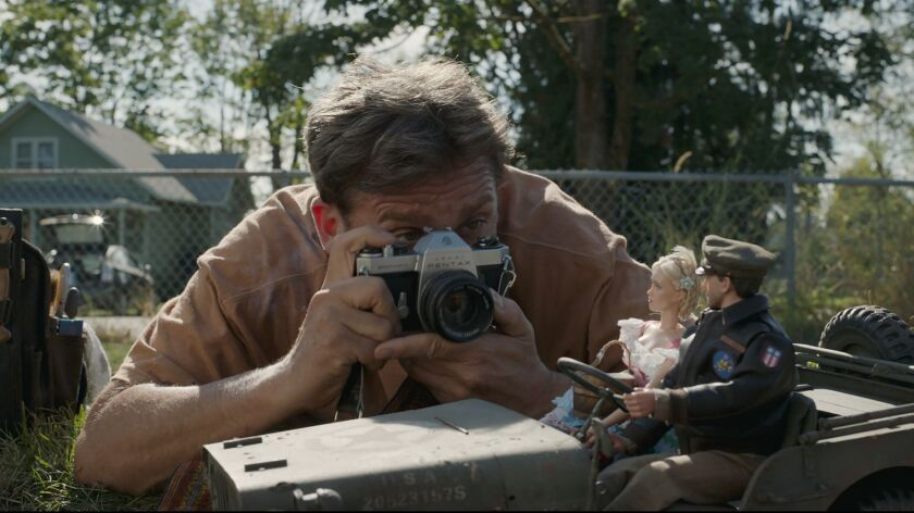 "Mark Hogancamp (Steve Carell) photographs the dolls for his fictional town in ""Welcome to Marwen,"" d"